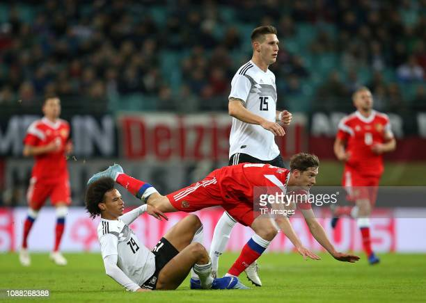 Leroy Sane of Germany and Aleksei Miranchuk of Russia and Niklas Suele of Germany battle for the ball during the International Friendly match between...