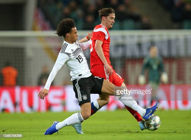 Leroy Sane of Germany and Aleksei Miranchuk of Russia battle for the ball during the International Friendly match between Germany and Russia at Red...