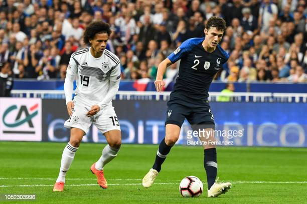 Leroy Sane of Germany and Benjamin Pavard of France during the UEFA Nations League A group one match between France and Germany at Stade de France on...