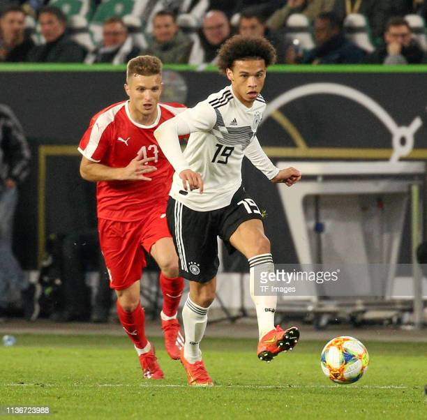 Leroy Sane of Germany and Darko Lazovic of Serbia battle for the ball during the International Friendly match between Germany and Serbia at...