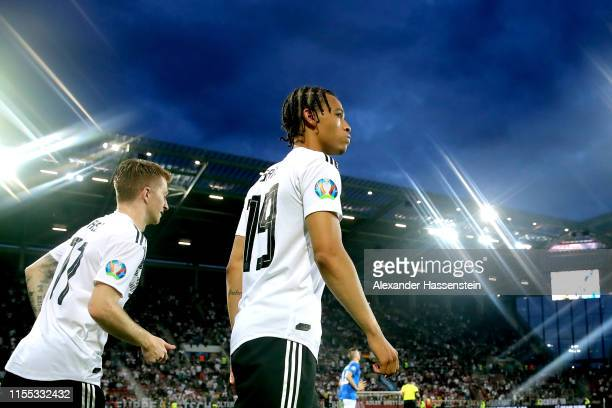 Leroy Sane of Germany and team mate Marco Reus enter the field of play for the UEFA Euro 2020 Qualifier match between Germany and Estonia at Opel...