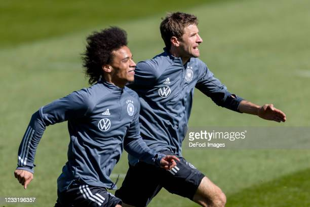 Leroy Sane of Germany and Thomas Mueller of Germany look on during Day 3 of the Germany Seefeld Training Camp on May 30, 2021 in Seefeld in Tirol,...