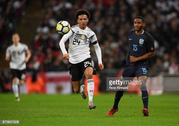 Leroy Sane of Germany attempts to get away from Joe Gomez of England during the International friendly match between England and Germany at Wembley...