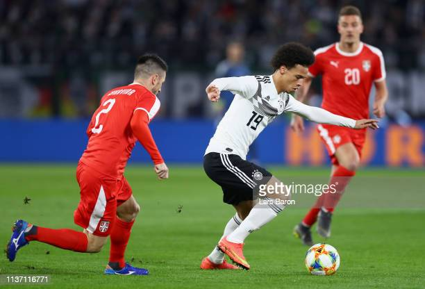 Leroy Sane of Germany battles for possession with Antonio Rukavina of Serbia during the International Friendly match between Germany and Serbia at...