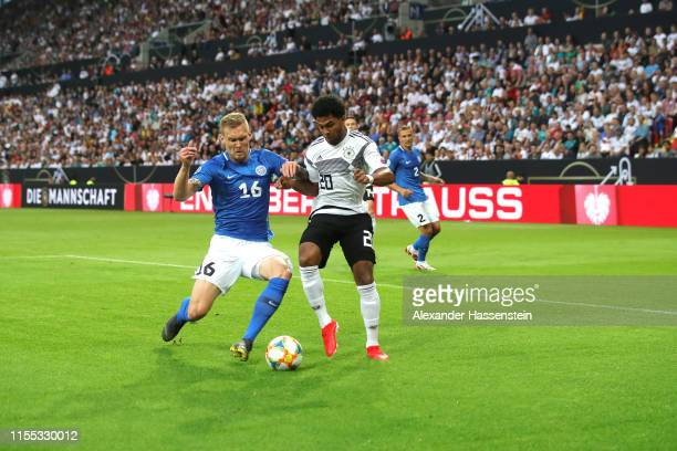 Leroy Sane of Germany battles for the ball with Joonas Tamm of Estonia during the UEFA Euro 2020 Qualifier match between Germany and Estonia at Opel...