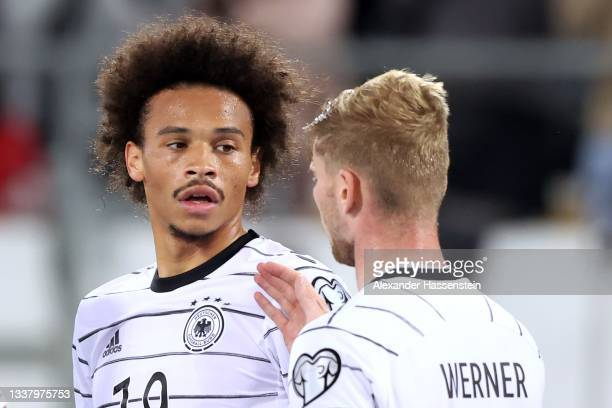 Leroy Sane of Germany celebrates scoring the 2nd team goal with team mate Timo Werner during the 2022 FIFA World Cup Qualifier match between...