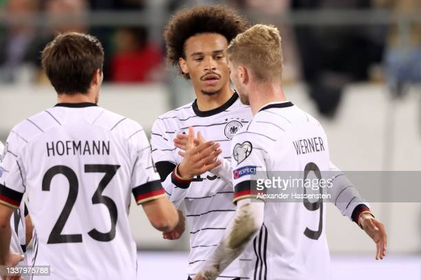 Leroy Sane of Germany celebrates scoring the 2nd team goal with team mated Timo Werner and Jonas Hofmann during the 2022 FIFA World Cup Qualifier...