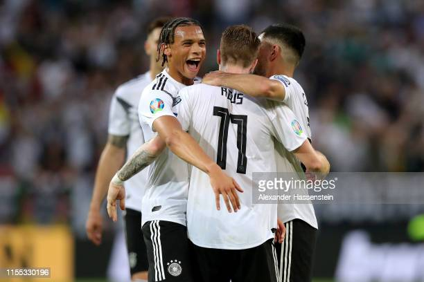 Leroy Sane of Germany celebrates scoring the 5th goal with team mates Marco Reus and Ilkay Guendogan during the UEFA Euro 2020 Qualifier match...