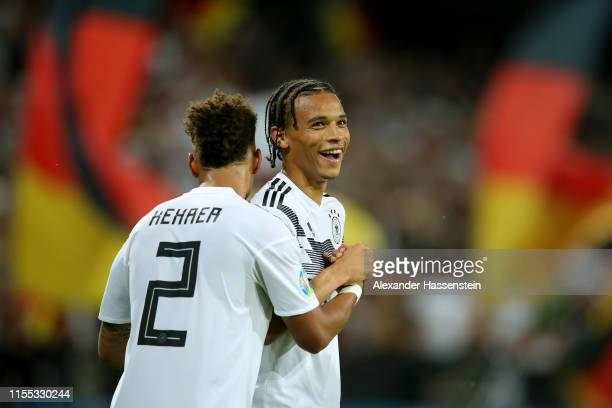 Leroy Sane of Germany celebrates scoring the 8th goal with team mate Thilo Kehrer during the UEFA Euro 2020 Qualifier match between Germany and...