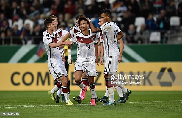 Leroy Sane of Germany celebrates with team mates as he scores the opening goal during the 2017 UEFA European U21 Championships Qualifier between U21...