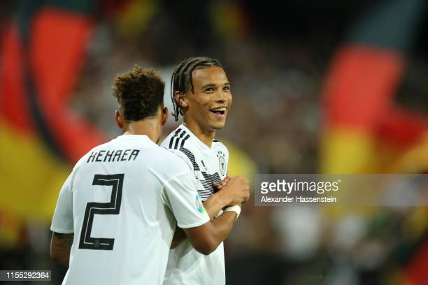 Leroy Sane of Germany celebrates with teammate Thilo Kehrer of Germany after scoring his team's eighth goal during the UEFA Euro 2020 Qualifier match...