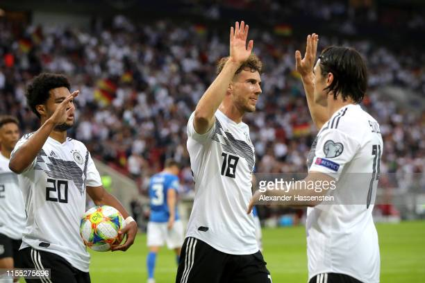 Leroy Sane of Germany celebrates with teammates Serge Gnabry and Leon Goretzka of Germany after scoring his team's second goal during the UEFA Euro...