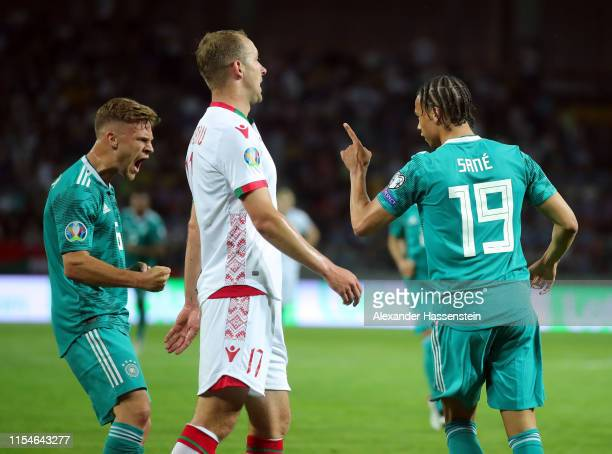Leroy Sane of Germany celebrtaes with teammate Joshua Kimmich after scoring during the UEFA Euro 2020 qualifier match between Belarus and Germany at...