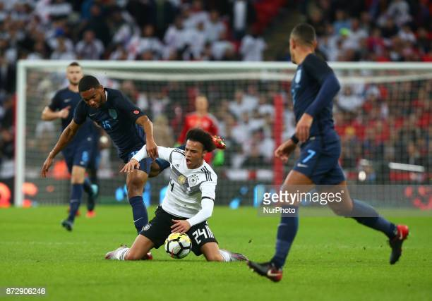 Leroy Sane of Germany gets tackled by England's Joe Gomez during International Friendly match between England and Germany at Wembley stadium London...