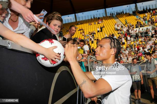 Leroy Sane of Germany gives autograophs after the Germany Internal Test Match at Tivoli Stadium on June 05, 2019 in Aachen, Germany.