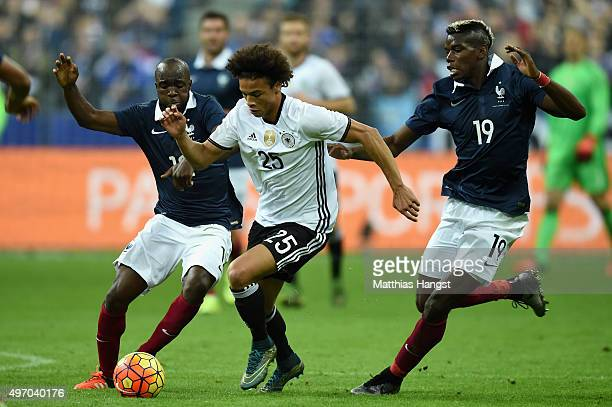 Leroy Sane of Germany holds off Lassana Diarra of France and Paul Pogba of France during the International Friendly match between France and Germany...
