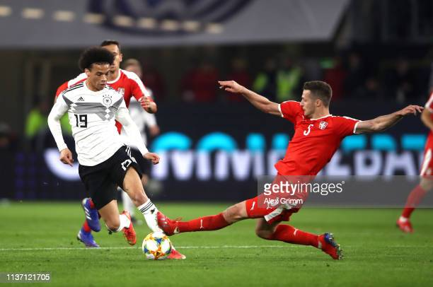 Leroy Sane of Germany in action while challanged by Uros Spajic of Serbia during the International Friendly match between Germany and Serbia at...
