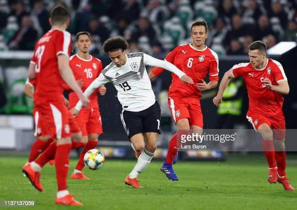 Leroy Sane of Germany in action while challenged by Nemanja Maksimovic of Serbia and Luka Jovic of Serbia during the International Friendly match...