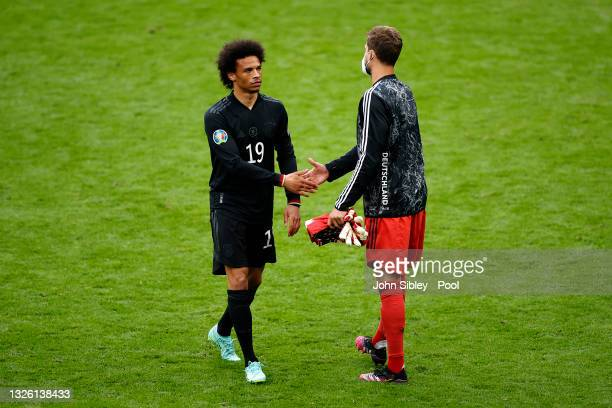 Leroy Sane of Germany interacts with teammate Kevin Trapp of Germany following their team's defeat in the UEFA Euro 2020 Championship Round of 16...