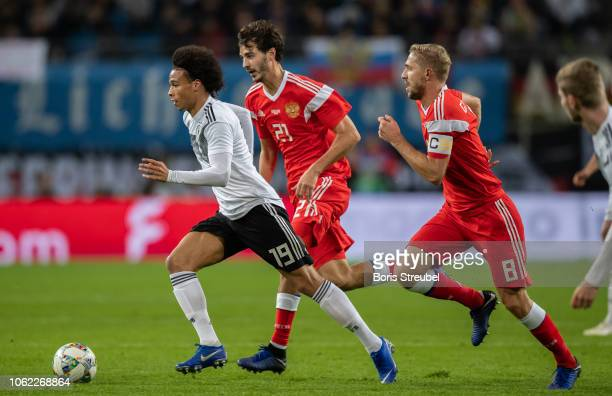Leroy Sane of Germany is challenged by Aleksandr Erokhin and Yuri Gazinskiy of Russia during the International Friendly match between Germany and...