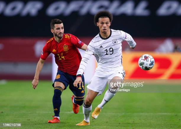 Leroy Sane of Germany is challenged by Jose Gaya of Spain during the UEFA Nations League group stage match between Spain and Germany at Estadio de La...