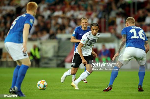 Leroy Sane of Germany is challenged by Madis Vihmann and Joonas Tamm of Estonia during the UEFA Euro 2020 Qualifier match between Germany and Estonia...