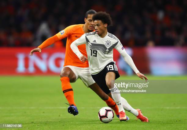 Leroy Sane of Germany is watched by Virgil van Dijk of the Netherlands during the 2020 UEFA European Championships Group C qualifying match between...