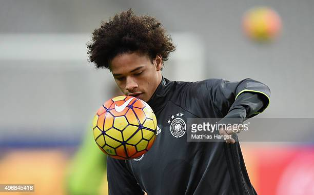Leroy Sane of Germany juggles a ball during a Germany training session ahead of their International Friendly against France at Stade de France on...