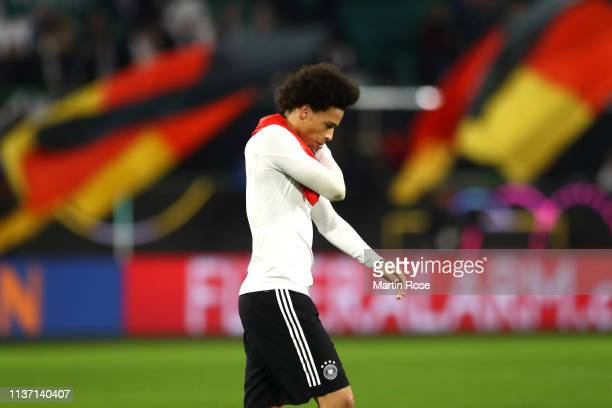 Leroy Sane of Germany looks dejected following his team's draw in the International Friendly match between Germany and Serbia at Volkswagen Arena on...