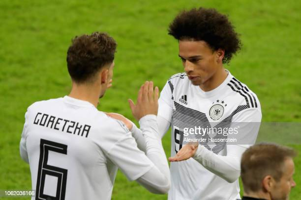Leroy Sane of Germany reacts with team mate Leon Goretzka during the International Friendly match between Germany and Russia at Red Bull Arena on...