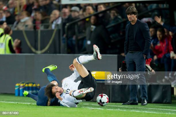 Leroy Sane of Germany und Ryan Bertrand battle for the ball during the international friendly match between Germany and England at Signal Iduna Park...