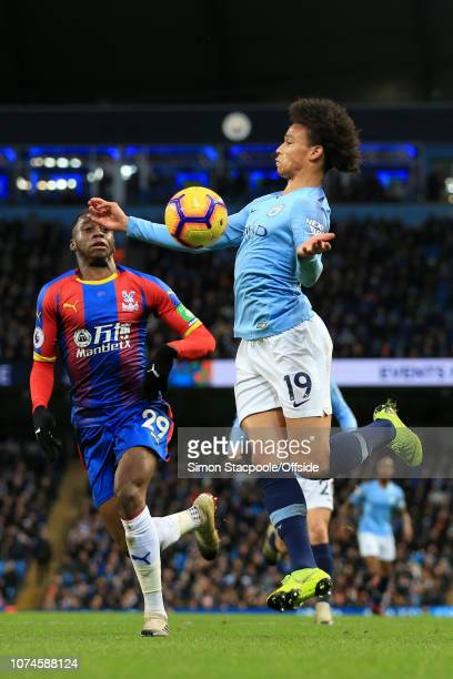 Leroy Sane of Man City battles with Aaron Wan-Bissaka of Palace during the Premier League match between Manchester City and Crystal Palace at the...