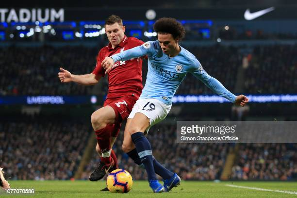 Leroy Sane of Man City battles with James Milner of Liverpool during the Premier League match between Manchester City and Liverpool at the Etihad...