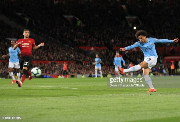 Leroy Sane of Man City scores their 2nd goal during the Premier League match between Manchester United and Manchester City at Old Trafford on April...