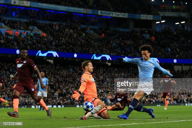 Leroy Sane of Man City scores their 2nd goal past Hoffenheim goalkeeper Oliver Baumann during the UEFA Champions League Group F match between...