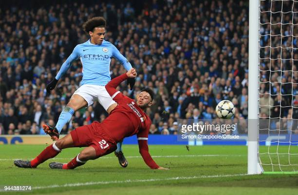 Leroy Sane of Man City shoots past Alex OxladeChamberlain of Liverpool to score their 2nd goal but it is controversially ruled offside during the...