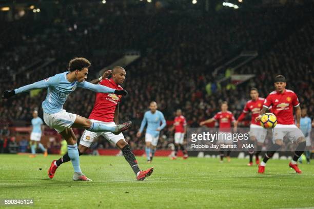 Leroy Sane of Manchester City and Ashley Young of Manchester United during the Premier League match between Manchester United and Manchester City at...