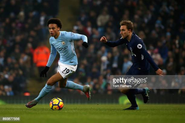 Leroy Sane of Manchester City and Christian Eriksen of Tottenham Hotspur in action during the Premier League match between Manchester City and...