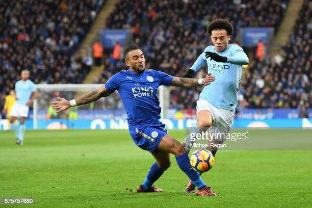 Leroy Sane of Manchester City and Danny Simpson of Leiceter City compete for the ball during the Premier League match between Leicester City and...