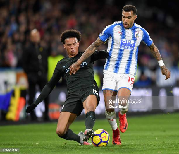 Leroy Sane of Manchester City and Danny Williams of Huddersfield Town in action during the Premier League match between Huddersfield Town and...