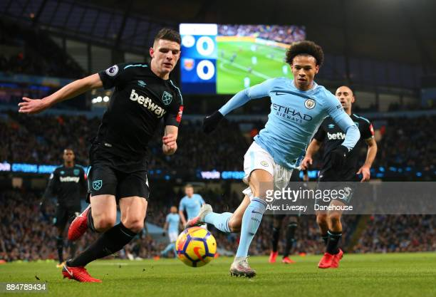 Leroy Sane of Manchester City and Declan Rice of West Ham United compete for the ball during the Premier League match between Manchester City and...