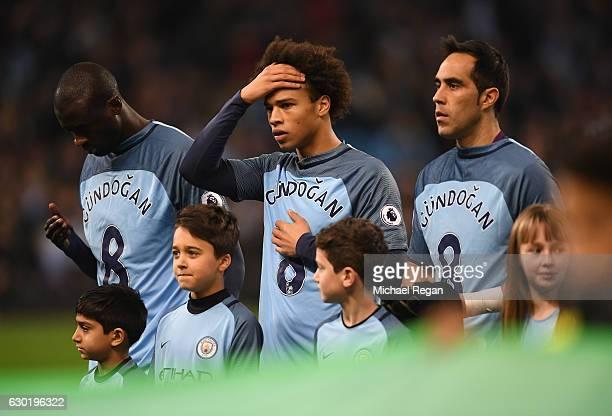 Leroy Sane of Manchester City and his Manchester City team mates wear Ilkay Gundogan of Manchester City shirt in surport for him after he was injured...