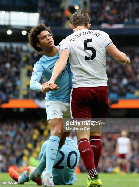 Leroy Sane of Manchester City and James Tarkowski of Burnley clash during the Premier League match between Manchester City and Burnley at Etihad...