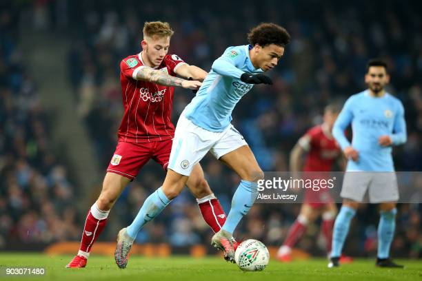 Leroy Sane of Manchester City and Josh Brownhill of Bristol City in action during the Carabao Cup SemiFinal First Leg match between Manchester City...