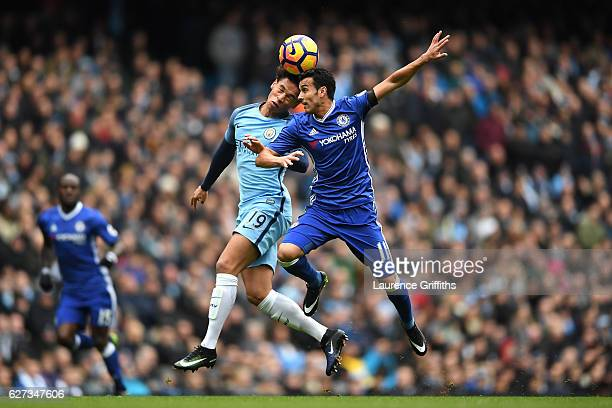 Leroy Sane of Manchester City and Pedro of Chelsea compete for the ball during the Premier League match between Manchester City and Chelsea at Etihad...