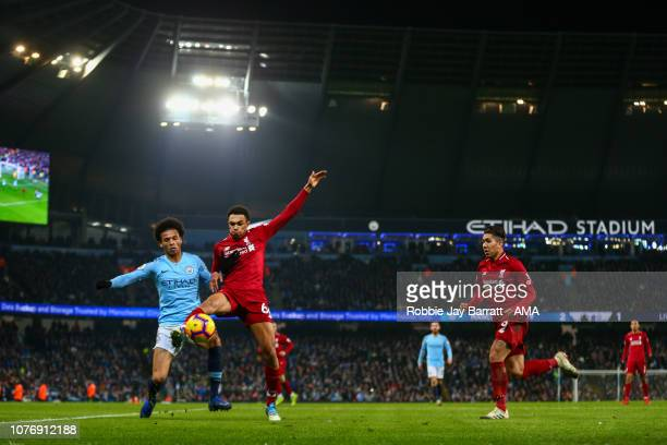 Leroy Sane of Manchester City and Trent AlexanderArnold of Liverpool during the Premier League match between Manchester City and Liverpool FC at...