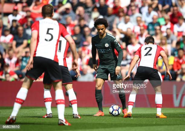 Leroy Sane of Manchester City battle for possession with Cedric Soares of Southampton during the Premier League match between Southampton and...