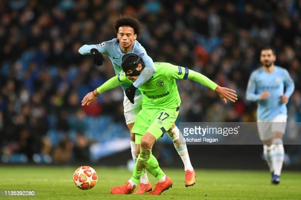 Leroy Sane of Manchester City battles for possession with Benjamin Stambouli of FC Shalke 04 during the UEFA Champions League Round of 16 Second Leg...