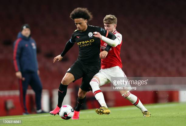 Leroy Sane of Manchester City battles for possession with Zak Swanson of Arsenal during the Premier League 2 match between Arsenal U23 and Manchester...