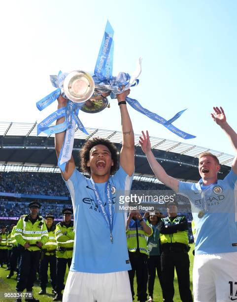Leroy Sane of Manchester City celebrate with The Premier League Trophy after the Premier League match between Manchester City and Huddersfield Town...